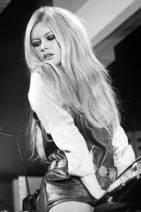 <p>The French beauty was known to add length to her teased, platinum blonde mane.</p>