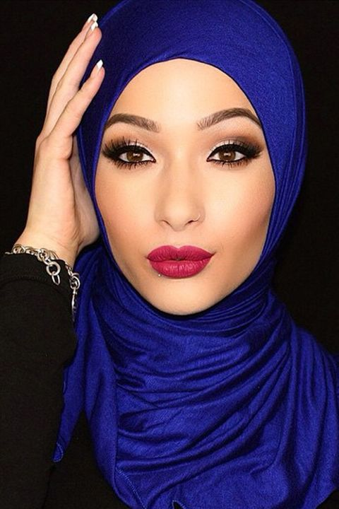 Nose, Blue, Lip, Forehead, Eyebrow, Eyelash, Violet, Purple, Electric blue, Headgear,