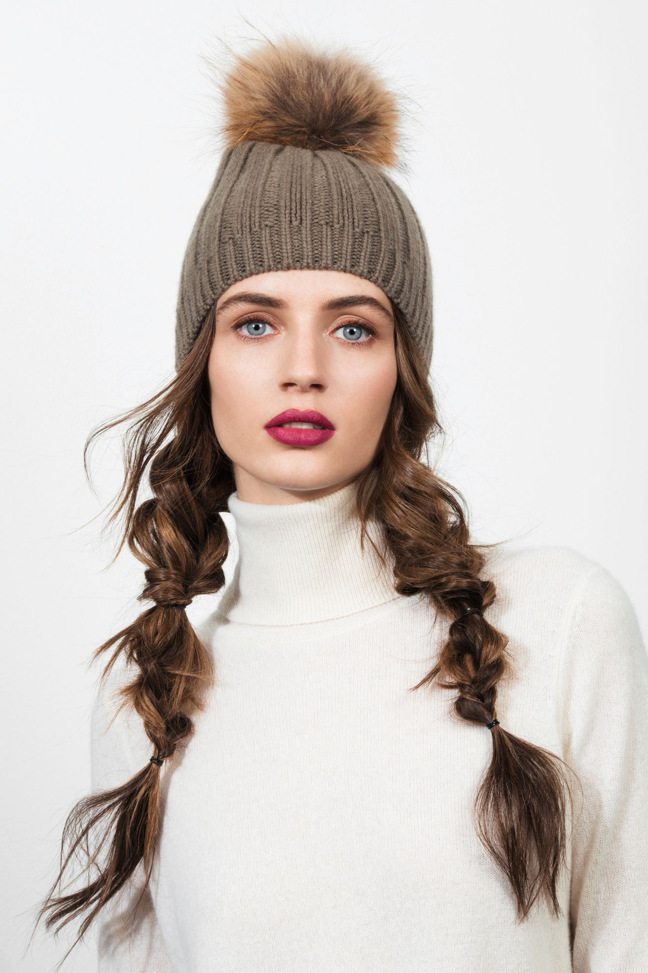 "<p>Pigtails are a beanie no-brainer—the rougher and more deconstructed the better when there's a pom-pom in the mix. Alternate between fishtail-braiding, tying knots and doing the classic three-strand weave down the length. </p><p><strong>Joseph</strong> Cashmere Luxe Pompon Hat, $195, <a href=""http://www.joseph-fashion.com/hats/cashmere-luxe-pompon-hat/invt/w5123090709440"" target=""_blank"">joseph-fashion.com</a>.</p>"