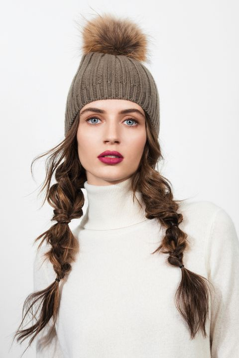 """<p>Pigtails are a beanie no-brainer—the rougher and more deconstructed the better when there's a pom-pom in the mix. Alternate between fishtail-braiding, tying knots and doing the classic three-strand weave down the length. </p><p><strong>Joseph</strong> Cashmere Luxe Pompon Hat, $195, <a href=""""http://www.joseph-fashion.com/hats/cashmere-luxe-pompon-hat/invt/w5123090709440"""" target=""""_blank"""">joseph-fashion.com</a>.</p>"""