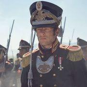 Chin, Uniform, Collar, Headgear, Costume accessory, Tradition, Soldier, Costume hat, Military person, Grenadier,