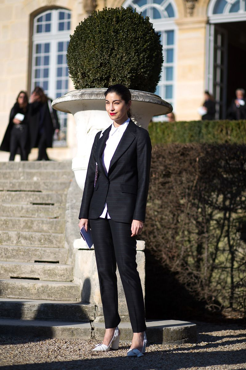 <p>You can never go wrong with a classic black suit. To keep the look minimal, style a crisp white button-down underneath. To add a little bit of flair, go for a bright-colored blouse or turtleneck instead. </p>