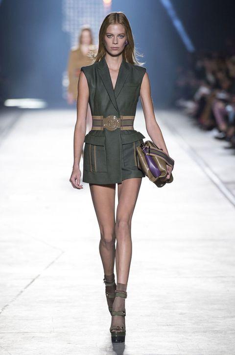 Clothing, Fashion show, Brown, Shoulder, Human leg, Joint, Runway, Fashion model, Style, Waist,