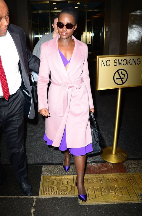 <p>Who: Lupita Nyong'o</p><p>When: February 3, 2016</p><p>Why: Lupita Nyong'o combines sweet, sexy, and feminine in a pink Escada coat, a Michael Kors cutout dress, and matching SJP heels. The sliver of midriff peaking out from her coat is the perfect unexpected detail.</p><p><span></span></p>