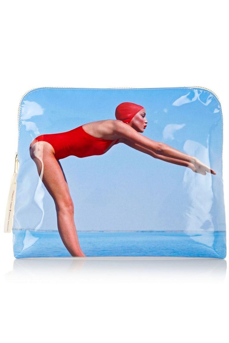 "<p>Charlotte Tilbury The Bathing Beauty Bag, $80; <a href=""http://www.charlottetilbury.com/us/bathing-beauty-wash-bag-norman-parkinson.html"" target=""_blank"">charlottetilbury.com</a><br></p>"