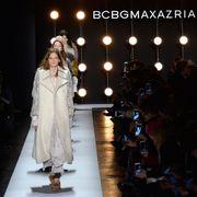 Human body, Formal wear, Fashion, Dress, Street light, Audience, Fashion design, Stage, Light fixture, Fashion model,