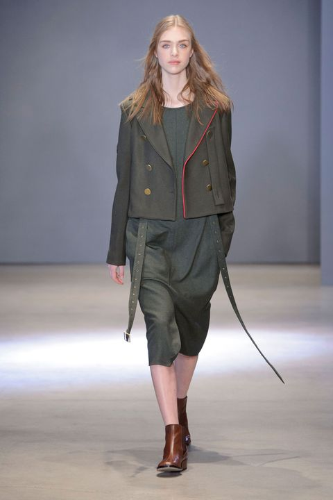 Clothing, Brown, Sleeve, Human body, Shoulder, Textile, Joint, Fashion show, Outerwear, Style,
