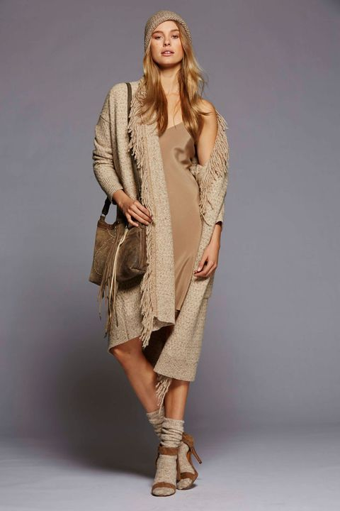 Clothing, Footwear, Brown, Sleeve, Human body, Shoulder, Textile, Joint, Outerwear, Fashion show,