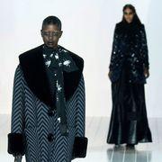 Sleeve, Standing, Formal wear, Style, Pattern, Fashion, Black, One-piece garment, Costume design, Blazer,