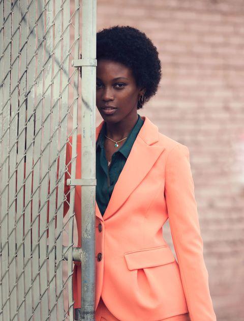 Jewellery, Sleeve, Collar, Jheri curl, Coat, Outerwear, Style, Blazer, Street fashion, Black hair,