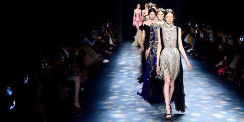 Fashion show, Dress, Runway, Fashion model, Fashion, Costume design, Darkness, Model, Public event, Waist,