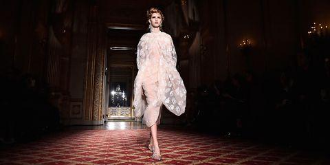 Fashion, Darkness, Fashion model, Flash photography, Performance art, Fashion design, One-piece garment, Haute couture, Foot, High heels,