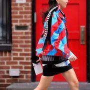 Clothing, Sleeve, Collar, Brick, Human leg, Outerwear, Coat, Street fashion, Plaid, Shorts,