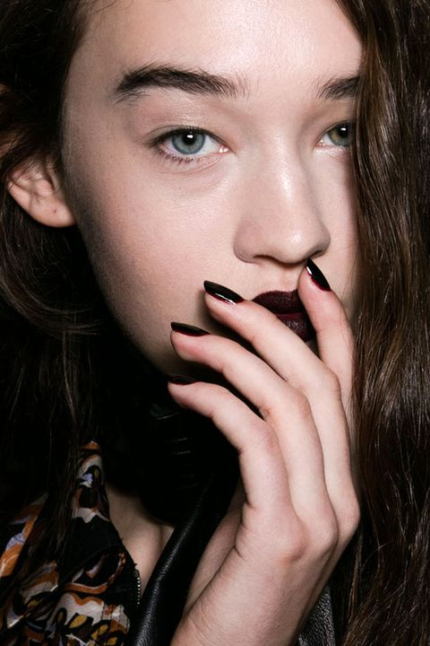 """<p>Manicurist Alicia Torello painted the models' nails in <a href=""""http://www.sallybeauty.com/infinite-shine-polish/SBS-293015,default,pd.html"""" target=""""_blank"""">We're in the Black</a> and outlined them in <a href=""""http://www.sallybeauty.com/infinite-shine-polish/SBS-293014,default,pd.html"""" target=""""_blank"""">Raisin the Bar, both by OPI</a>. <br></p>"""