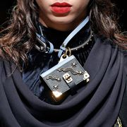 Collar, Fashion, Street fashion, Costume, Body jewelry, Fashion design, Fashion model, Costume accessory, Symbol, Button,