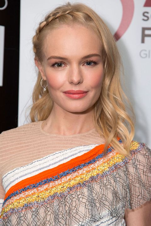 <p>Dutch braid down from a side part for an edgier version of the milkmaid.</p>