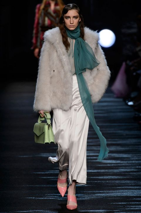 Clothing, Fashion show, Shoulder, Textile, Outerwear, Runway, Fashion model, Style, Winter, Fur clothing,