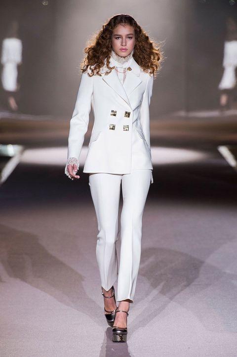 Shoulder, Joint, Fashion show, Outerwear, White, Fashion model, Style, Runway, Formal wear, Fashion,