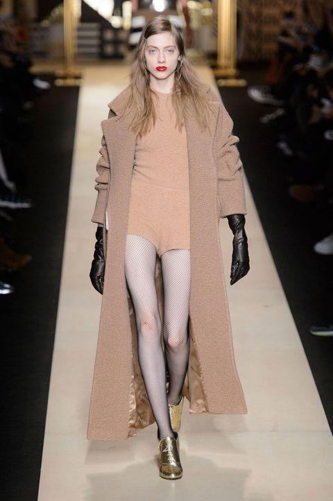 Fashion show, Textile, Outerwear, Human leg, Runway, Style, Fashion model, Street fashion, Fashion, Knee,
