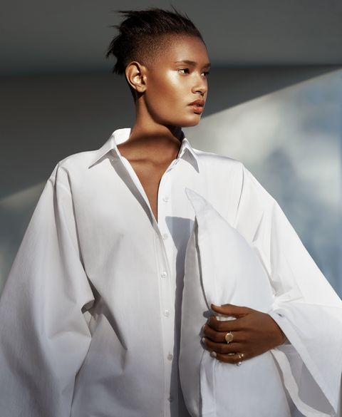 <p>Poplin shirt, Michael Kors Collection, $695, visit michaelkors.com. Silver and gold ring, Spinelli Kilcollin, $1,200. Gold and pearl ring, Sophie Bille Brahe, $697. </p>