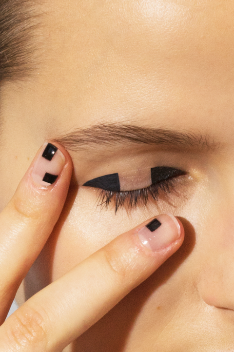 """<p>""""Negative space, or the unpainted parts of the nail, are my favorite! I find negative space makes nails feel a little more tomboy and less fussy,"""" says Poole. """"These nails have randomly placed squares and rectangles to correspond with the windowpane design on the eye."""" To get this look, use a striping brush to paint on black shapes, and clean up the edges with a small brush dipped in acetone. """"This look is meant to be minimal, so don't overload the nail with shapes,"""" she advises, """"keep it to one or two squares per fingernail. For an all-over glassy shine that protects your design, apply a layer of Sally Hansen Miracle Gel Top Coat.""""</p> <h5>Sally Hansen Miracle Gel Nail Polish Top Coat, $8, <a href=""""http://www.target.com/p/sally-hansen-miracle-gel-nail-polish-top-coat-100/-/A-15419864#prodSlot=medium_1_16&term=sally+hansen+miracle+gel""""><u>target.com</u></a>.</h5>"""