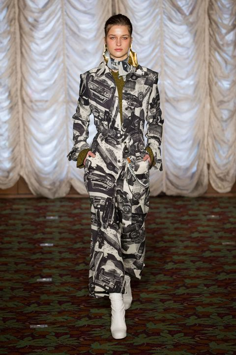 Flooring, Curtain, Fashion show, Runway, Fashion model, Window treatment, Camouflage, Fashion design, Military camouflage, Haute couture,