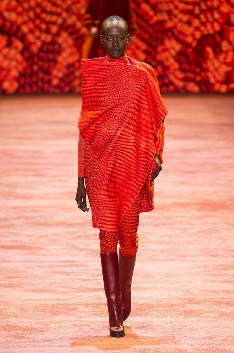 Textile, Red, Fashion show, Orange, Runway, Fashion, Fashion model, Knee, Street fashion, Boot,