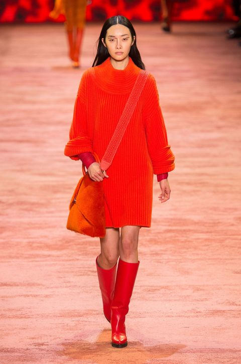 Sleeve, Human leg, Shoulder, Red, Joint, Outerwear, Orange, Fashion show, Amber, Street fashion,