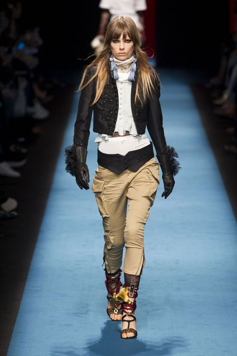 Brown, Fashion show, Shoulder, Joint, Runway, Outerwear, Fashion model, Style, Jacket, Knee,