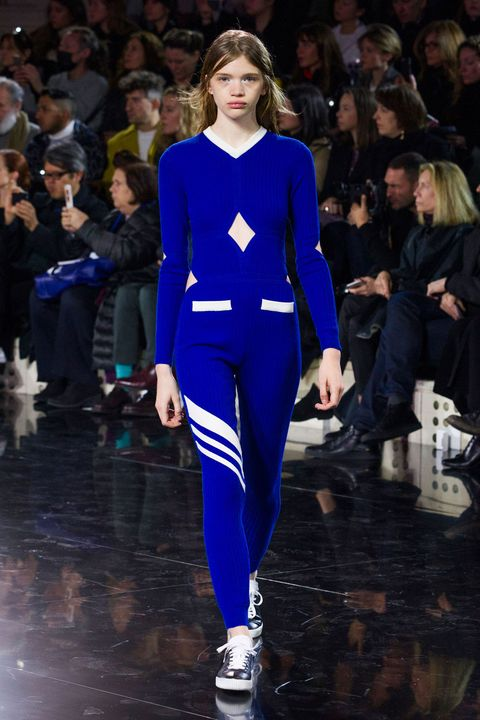 Clothing, Human, Fashion show, Trousers, Event, Runway, Outerwear, Style, Fashion model, Electric blue,