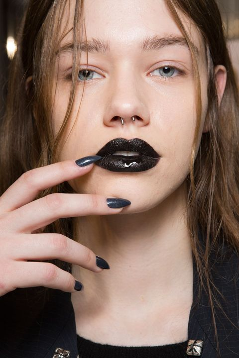 <p>Inspired by Vivienne Westwood's 'Japanese Buddhist punk spirituality,' Val Garland created a black lip using MAC Cosmetics. </p><p><span></span></p>