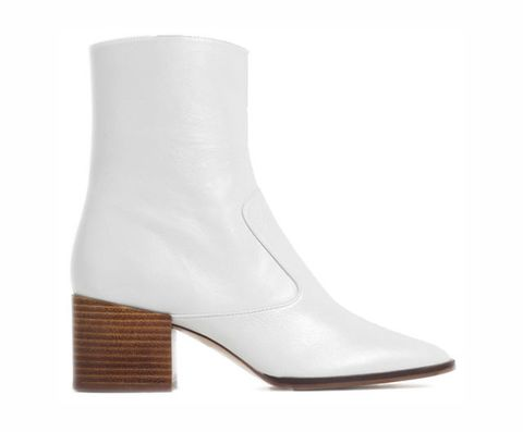 """<p>The key to making heeled boots comfortable is picking a pair with a low, block heel—like these ones from Zara. The white color is unexpected in winter, but will also work with just as much of your wardrobe as your go-to black pair.</p><p><strong>Block Heel Ankle Boots, $139, <a href=""""http://www.zara.com/us/en/woman/shoes/ankle-boots/block-heel-leather-ankle-boots-c358012p3154053.html""""><span>zara.com</span></a>.</strong><strong></strong><br></p>"""