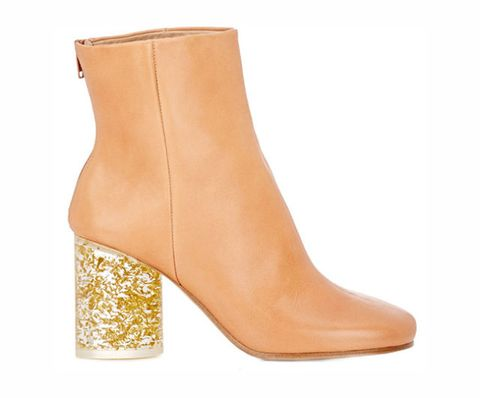 """<p>OK, these are a little more adventurous, but when we hear """"glitter-filled lucite heel"""" we don't immediately think refined. That's what makes these Margiela boots genius—the low heel and tan leather make them incredibly wearable.</p><p><strong>Maison Margiela Cylindrical-Heel Ankle Boots, $1,395, <a href=""""http://www.barneys.com/maison-margiela-cylindrical-heel-ankle-boots-504333572.html""""><span>barneys.com</span></a>.</strong><strong></strong><br></p>"""