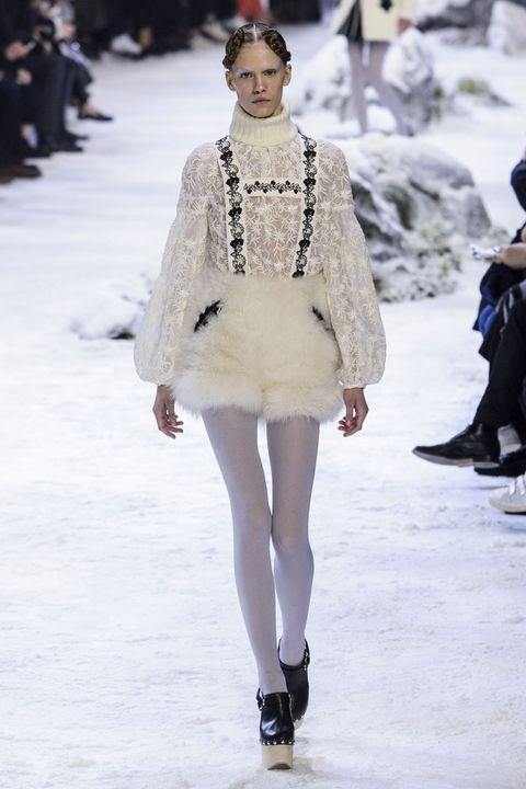 Clothing, Winter, Fashion show, Shoulder, Outerwear, Runway, Fashion model, Style, Street fashion, Fashion,