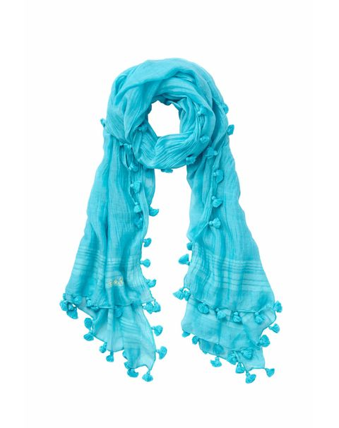 """<p>For the pattern-averse, this blue scarf gets its kicks from tiny pom-poms instead. It's a great, soft layering piece to pair with something tougher, like a leather jacket.</p><h5>Carly Scarf by Lilly Pulitzer, $88, <a href=""""http://www.lillypulitzer.com/product/accessories-shoes/scarves/carly-scarf/pc/61/c/247/8622.uts?swatchName=Sea+Blue"""" target=""""_blank""""><u>lillypulitzer.com</u></a>.</h5>"""