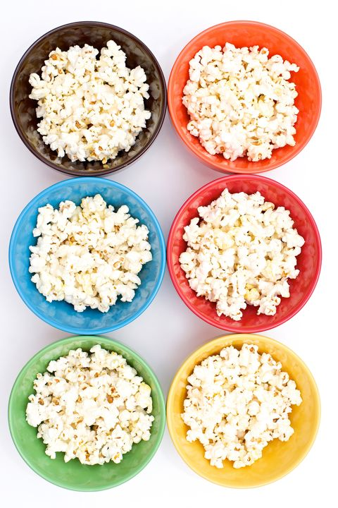 """<p>Go for air-popped kernels or even a microwaveable variety, as it makes for a great <a href=""""http://www.redbookmag.com/body/healthy-eating/advice/a11227/hungry-girl-healthy-mall-food/"""" target=""""_blank"""">guilt-free</a> snack, says Megan Madden, a registered dietitian in New York City. When shopping for microwave popcorn, look for brands lower in saturated fat and sodium, she says. Depending on the brand, you can usually enjoy two cups for under 150 calories—just don't overload on the butter, of course.</p>"""