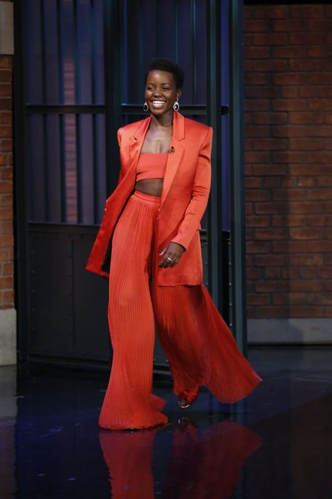 <p>Who: Lupita Nyong'o</p><p>When: March 14, 2016</p><p>Why: Lupita Nyong'o joined the Balmain army this week, wearing head-to-toe mandarin orange for an appearance on <em>Late Night With Seth Meyers</em>. Learn from her outfit and pair a crop top with an oversized blazer and billowy high-waist pants for somewhat modest look. </p>