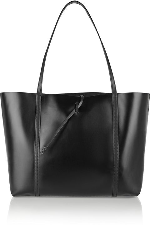 "<p>A bag that's polished enough for the office <em>and</em> useful for that massive grocery run? Sold! </p><p>Kara Tie leather tote, <span class=""currency style-scope nap-product-price"" style=""line-height: 1.6em; background-color: initial;"">$</span><span class=""full-price style-scope nap-product-price"" style=""line-height: 1.6em; background-color: initial;"">475, <a href=""https://www.net-a-porter.com/us/en/product/642011/kara/tie-leather-tote"">net-a-porter.com</a> </span></p>"