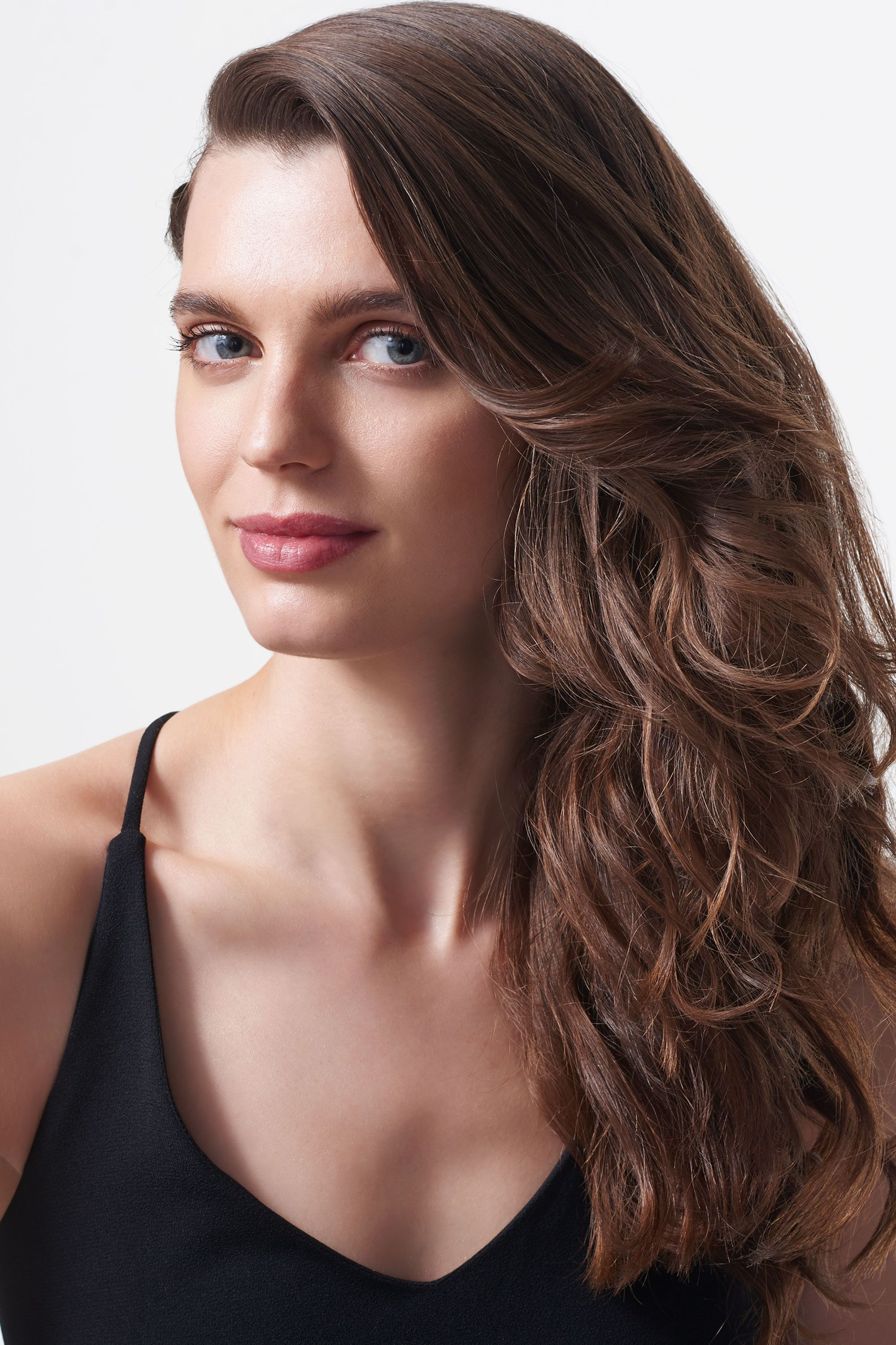 <p>This easy look (with the hair from one side pulled away from your face) pairs perfectly with a strapless gown — or one of those off-the-shoulder numbers.</p>