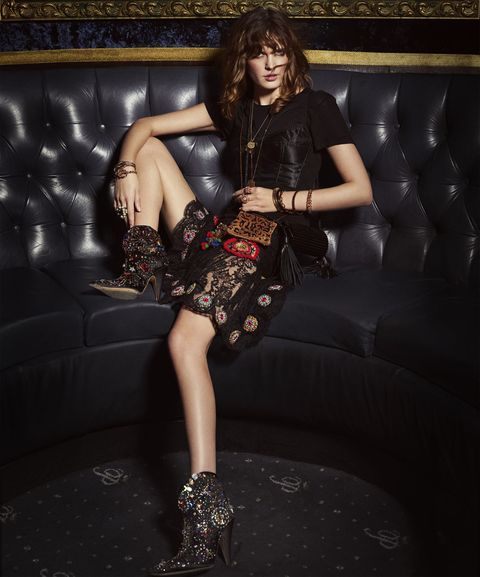 <p><em>Satin bra top, $895, silk brief, $295, embellished-lace skirt, price on request, all, Dolce & Gabbana, at select Dolce & Gabbana boutiques nationwide. Rayon-blend T-shirt, Rails, $78. Gold charm necklace, Lanvin, $595. Fringe necklace, Chloe, price on request. Gold bracelets, both, Max Mara, $350 each. Lucite bracelet, Alexis Bittar, $130. Horn and bronze bangle, Ashley Pittman, $695 (for set of three). Gold bangles, $45–$55 each, gold and black cabochon bangle, $90, all, Kenneth Jay Lane. Crystal, glass pearl, and gold-finish metal ring, Gucci, $915. Rose gold and diamond ring; rose gold, morganite, spinel, and pearl ring, both, Cartier, prices on request. Plexiglas minaudière, $1,790, sequin handbag, $1,890, both, Saint Laurent by Hedi Slimane. Embellished-satin boots, Marc Jacobs, price on request.</em></p>