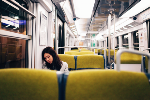 Girl Sleeping on Train