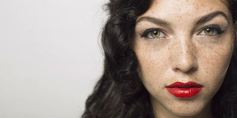 Woman with freckles and red lipstick