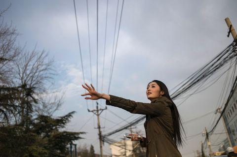 Woman hailing a cab.