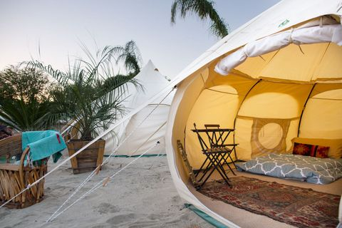 "<p>You may not <em>think</em> you're down for camping, but <a href=""http://lotusbelle.com"">Lotus Belle's luxury tents</a> might change your mind. The sustainably made, luxury canvas structures combine the functionality of a Bell Tent with the design of a Mongolian Yurt. They come in three different sizes (the two person Lotus Bud, 13 feet, and 16 feet) and can be easily assembled by one person. The ones we saw at Coachella had beds and chairs in them! Trust and believe you'll want to skip the insanely-expensive hotel rooms and do this instead. </p>"