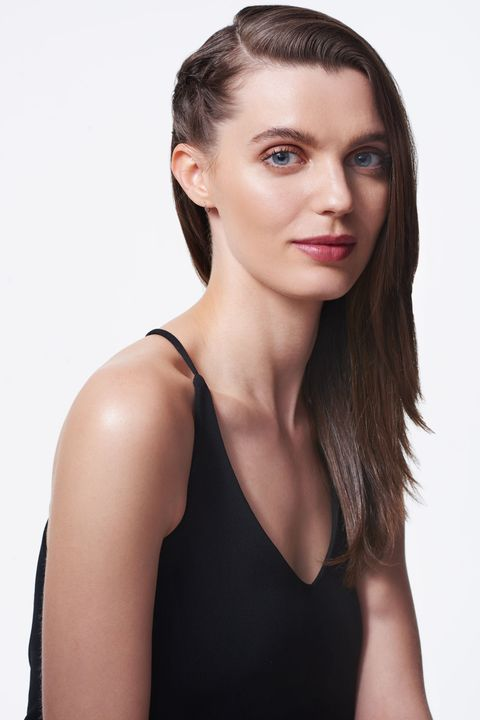 <p>Make a deep side part and blow-dry your hair. Grab a two-inch section below the part and French braid it toward the back of your head. If your braiding skills are iffy, twist the hair instead.</p>