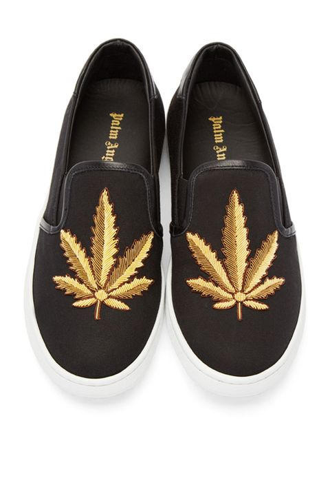 "<p> Palm Angels Embroidered Leaf Slip On Sneakers, $360; <a href=""https://www.ssense.com/en-us/women/product/palm-angels/black-embroidered-leaf-slip-on-sneakers/1435443"" target=""_blank"">ssense.com</a></p>"