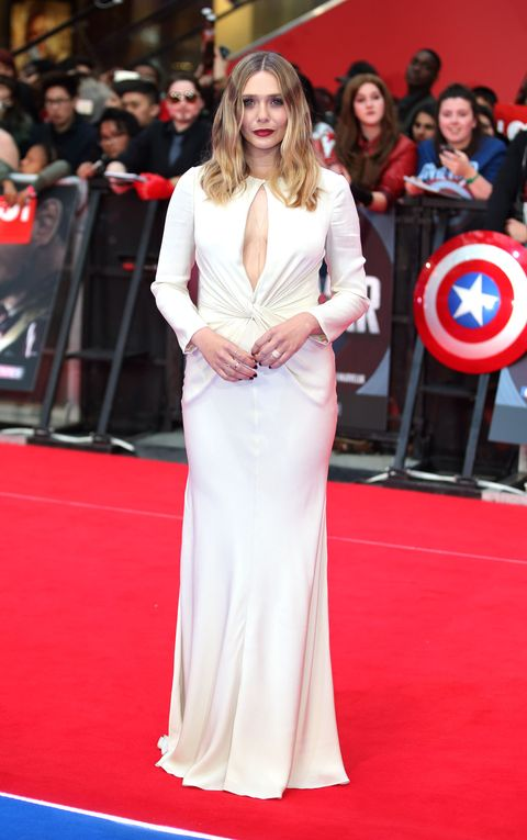 "<p>Who: Elizabeth Olsen </p><p>When: April 26, 2016 </p><p>Why: $10 says we weren't the only ones whose <a href=""http://www.eonline.com/news/760241/this-is-what-chris-evans-was-really-thinking-while-staring-at-elizabeth-olsen-s-cleavage"" target=""_blank"">jaws dropped when they saw Elizabeth Olsen</a> in this Alexander McQueen gown at the European premiere  of<em> Captain America: Civil War</em>. The open-keyhole is flattering to Olsen's figure, but doesn't look too sexy thanks to it's long sleeves and floor-length hem. </p>"