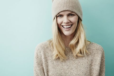Clothing, Lip, Sleeve, Shoulder, Textile, Wool, Facial expression, Sweater, Woolen, Headgear,