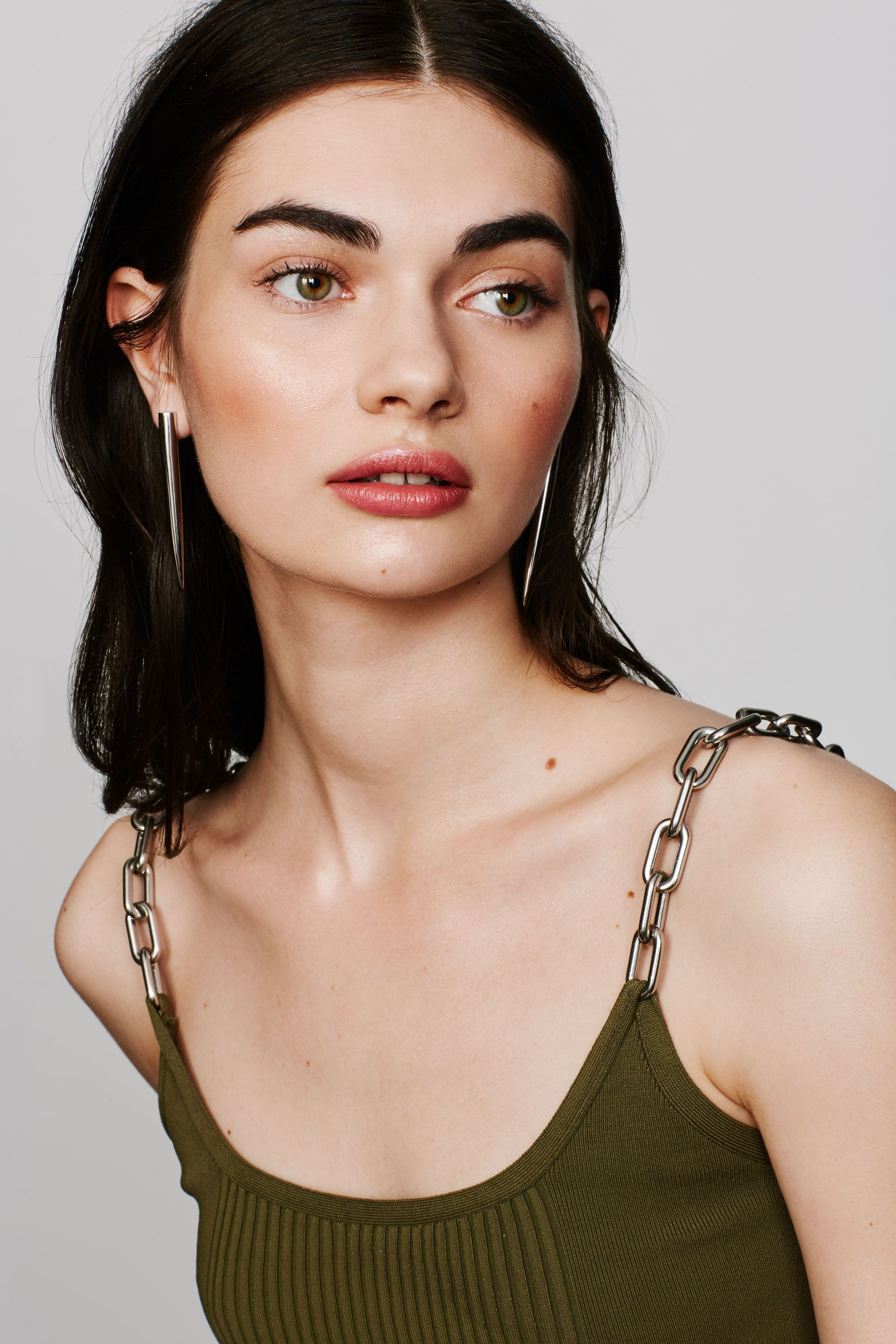 "<p>A dagger-like style gives any look a dose of hard edge cool. </p><p><br></p><p><br></p><p>Eddie Borgo Spike Drop Earrings, $175, <a href=""http://shop.nordstrom.com/s/eddie-borgo-spike-drop-earrings/4243985?&cm_mmc=Mindshare_Nordstrom-_-MayCorp-_-Hearst-_-proactive"" target=""_blank"">nordstrom.com</a>&#x3B; Alexander Wang Runway Bike Chain Bra Top, $375, <a href=""http://www.alexanderwang.com/us/shop/women/tops-top-runway-bike-chain-bra-top_cod37848638xe.html"" target=""_blank"">alexanderwang.com</a></p>"
