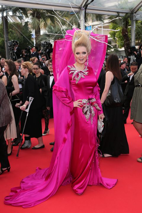 Event, Flooring, Textile, Outerwear, Magenta, Pink, Carpet, Style, Coat, Formal wear,